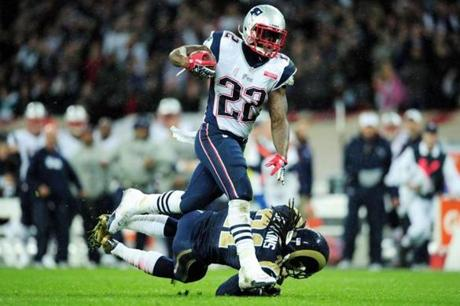 Patriots running back Stevan Ridley tried to escape Rams defender Janoris Jenkins.