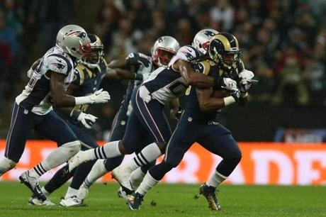 Rams running back Daryl Richardson was chased down by the Patriots defence.