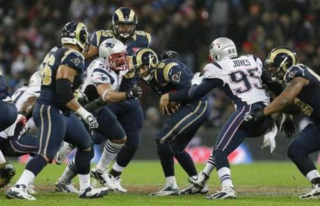 The Patriots defense converged on Rams quarterback Sam Bradford for a sack in the second half.