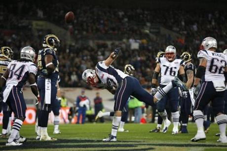 Patriots tight end Rob Gronkowski celebrated after making his first touchdown catch during the first half.