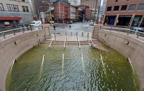 The plaza along Water Street was flooded after Hurricane Sandy left most of lower Manhattan without power.