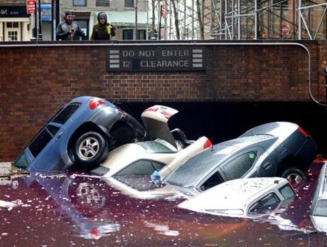 Cars were half-submerged in a flooded parking lot in New York City.