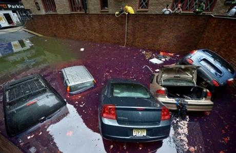Cars were half-submerged in a flooded parking lot New York City.
