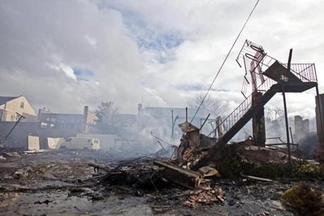 The Breezy Point section of Queens, N.Y., smoldered after a fire destroyed dozens of homes and vehicles during Hurricane Sandy.