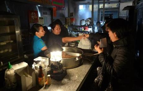 Food was served at the Mee Sun Cafe in Chinatown as power to most of lower Manhattan was lost.