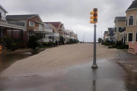Sand covered a street in Margate City, N.J.