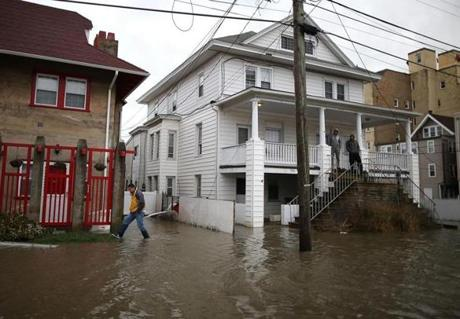 People inspected a flooded street in Ocean City, N.J.