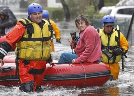 Emergency personnel rescued a resident from flood waters in Little Ferry, N.J.