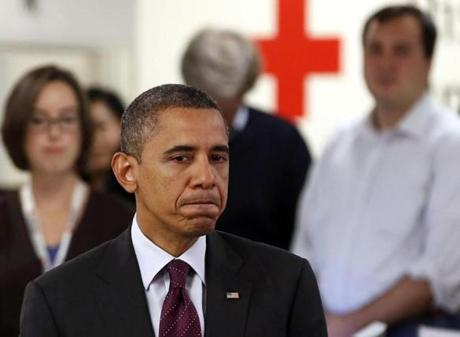 President Obama paused while he spoke at the National Red Cross Headquarters in Washington about damage done by Hurricane Sandy.
