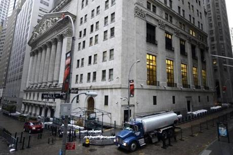 The New York Stock Exchange remained closed on Tuesday as New Yorkers cleaned up the morning after Hurricane Sandy.