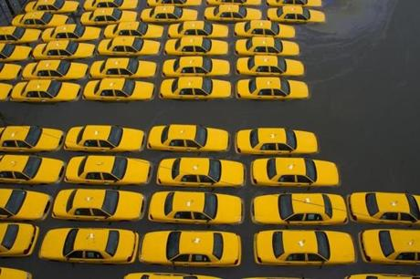 A parking lot full of yellow cabs was flooded in Hoboken, N.J., on O