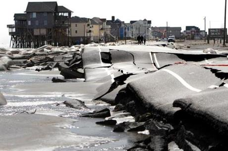 North Carolina Route 12 was buckled from pounding surf leading into Mirlo Beach in Rodanthe, N.C.