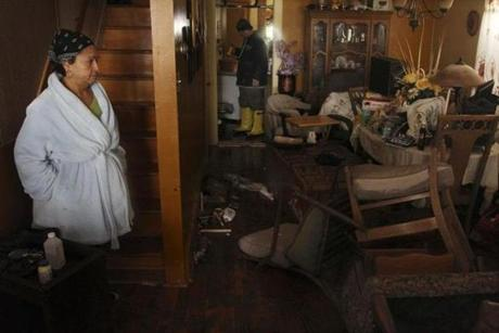 Virgen Perez, left, and her husband, Nelson Rodriguez, looked around their flooded home in Atlantic City, N.J.