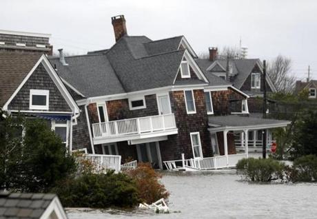 Floodwaters surrounded homes near the Mantoloking Bridge in Mantoloking, N.J.