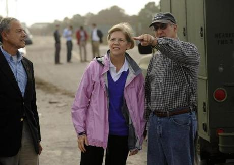 Elizabeth Warren was accompanied by State Representative Paul A. Schmid, left, and State Senator Michael Rodrigues, right, in Westport Tuesday.