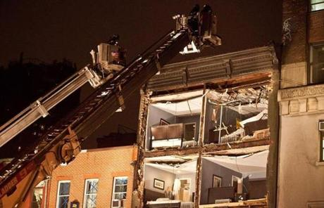Firefighters evacuated an apartment building in New York after its front wall collapsed.