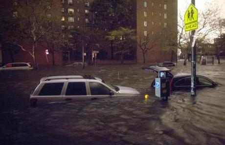 Vehicles are submerged on 14th Street in New York.