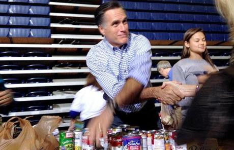Mitt Romney collected food donations at a campaign event in Ohio.