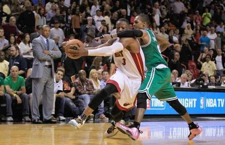 Rajon Rondo collars Heat guard Dwyane Wade in the fourth quarter, a play for which Rondo got a flagrant 1 foul.