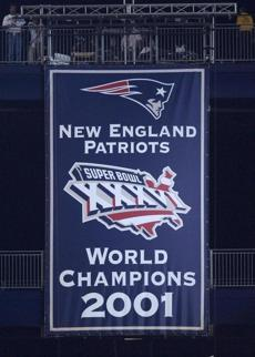 The Patriots unveiled their championship banner from Super Bowl XXXVI.