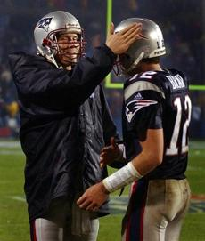 Drew Bledsoe (left) gave Tom Brady a pat on the head following a fourth quarter touchdown.