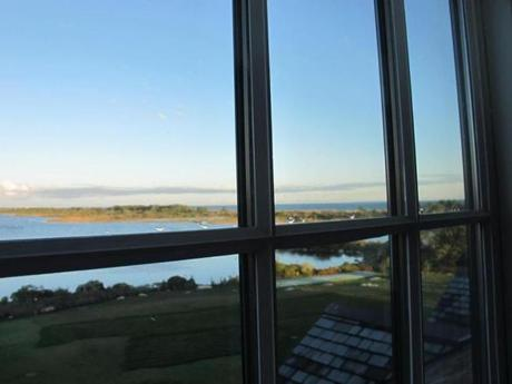"From the window of a ""pond view"" room at the Weekapaug Inn, one can see Quonochontaug Pond and, in the distance, the Atlantic."