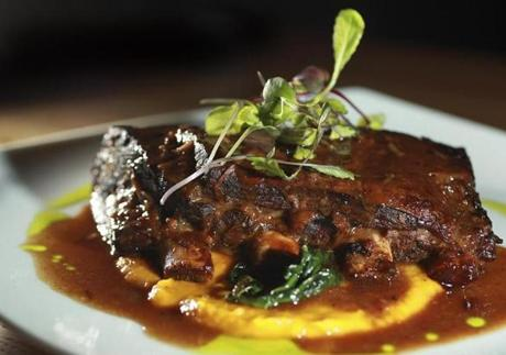 The Tip Tap Room's antelope short rib braised in horseradish and red wine over cinnamon-spiked roasted pumpkin puree.