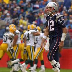 Brady left the field after throwing one of his three interceptions.