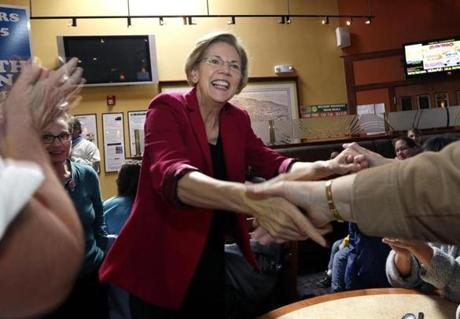 Elizabeth Warren greeted supporters at a Woburn restaurant.