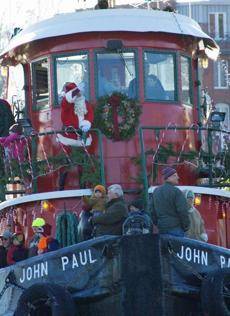 Santa waved to onlookers as he arrived in Mystic.
