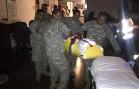 New York Army National Guard soldiers rush to evacuate a patient from Bellevue Hospital in New York Wednesday.