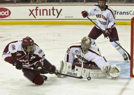 Boston College Eagles goalie Parker Milner denies UMass Minuteman Rocco Carzo a shot on goal at the Conte Forum. Nov. 4, 2012.