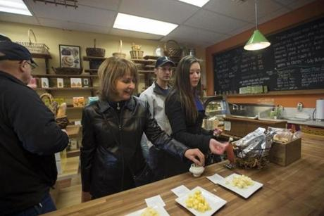 Jan Theberge, of Westport, Mass., and her daughter-in-law Missy Theberge, of Bridgewater, Mass., tasted cheese at Le Petit Gourmet as they participated in the Newport Gourmet Tour on Nov. 3.