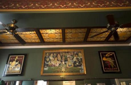 The painting over the bar of the Canfield House alludes to the restaurant's colorful past.