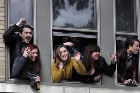 A crowd of young fans watched from a Commonwealth Avenue apartment where members of Aerosmith once lived as the band gave a concert in front of the Allston building.