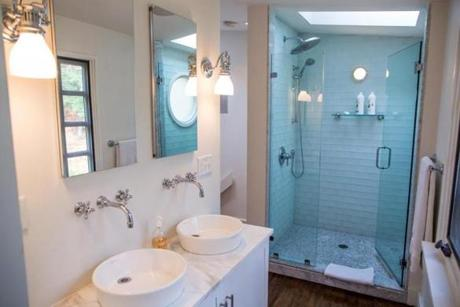 The cheerymaster bathroom includes a spacious shower with glass doors.
