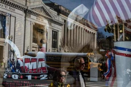 A street scene was reflected in the window of a gift shop near the White House in Washington, D.C.
