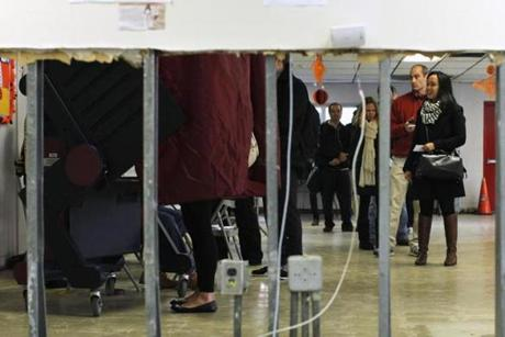 People lined up to vote at a polling station set up for those affected by Sandy in Hoboken, N.J.