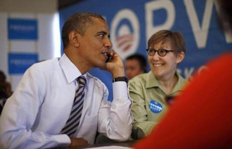 President Obama sat next to volunteer Carla Windhorst as he calls other volunteers during a visit to a campaign field office  in Chicago.