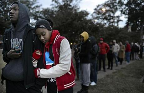 SLIDER William Wright, left, and India Johnson, right, both freshman at ODU, wait on line to vote at Larchmont Elementary School in Norfolk, Va. on Tuesday, Nov. 6, 2012. Wright and Johnson, both 18 and from Richmond, were excited to cast their first votes in the Presidential election. (AP Photo/The Virginian-Pilot, Amanda Lucier)