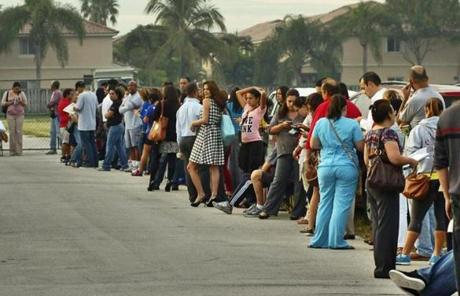 Voters waited in line to cast their ballots in Miami. (AP Photo/The Miami Herald, Tim Chapman) MAGS OUT