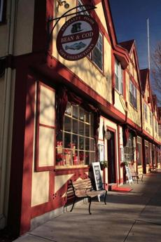 Attractive storefronts, benches, and free parking make downtown Falmouth a popular shopping destination.