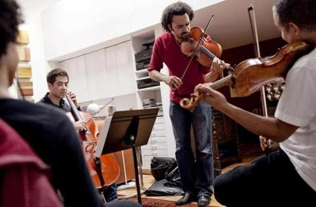 White, cellist candidate Matt Zalkind, Hernandez, and Gavilán played together during the audition.