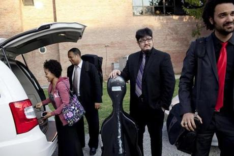 White, Gavilán, Wiancko, and Hernandez unloaded their equipment from the van in Yellow Springs, Ohio, on March 17, 2012.