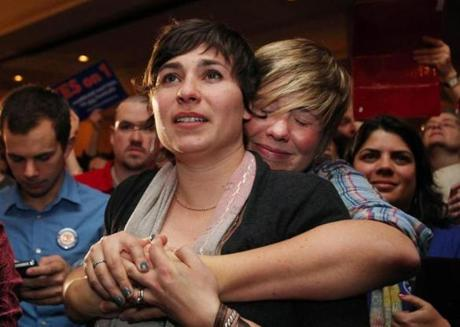 Lauren Snead (right) hugged her partner, Katy Jayne, in Portland, Maine.