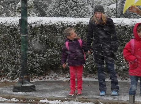 Amy DiMarzio and her five year old daughter Kate left the school as the snow came down.