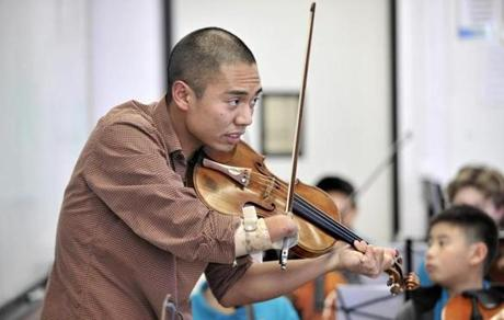 Anantawan has only one arm, but he is an accomplished violinist now training a youth orchestra in one of Boston's poorest neighborhoods.