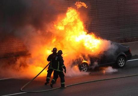 An automobile fire blocked rush hour traffic southbound on the Southeast Expressway on Nov. 8.