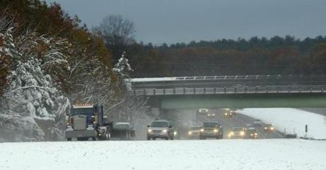 Traffic on I-495 near Norfolk drove through a mix of freezing rain and snow as a layer of snow covered the ground.
