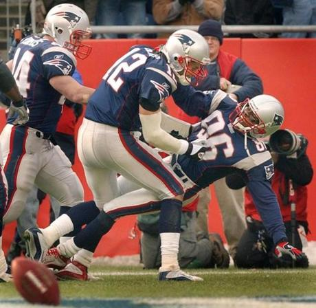 Tom Brady, center, knocked down David Patten as they celebrated the receiver's first-quarter touchdown.